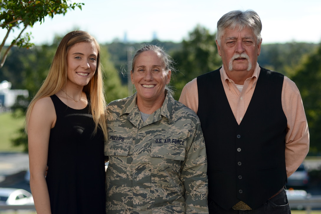 U.S. Air Force Chief Master Sgt. Lisa Phillips (center) poses for family pictures following her recent promotion at the North Carolina Air National Guard Base, Charlotte Douglas International Airport, Oct. 13, 2018. Phillips is the first female Chief Master Sgt. ever assigned to the 145th Maintenance Group.