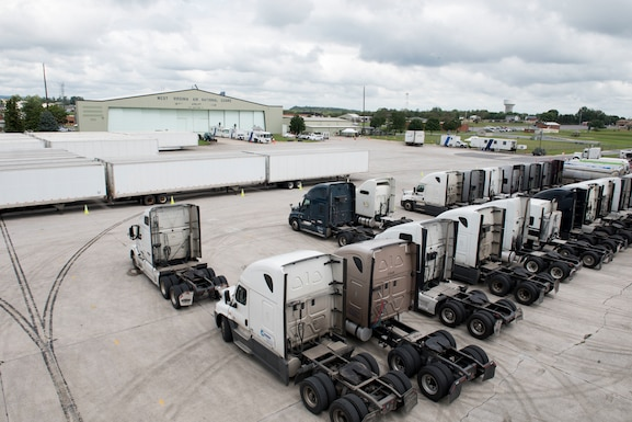 Tractors and trailers full of emergency relief supplies set on stand-by on the transient ramp at the 167th AIrlift Wing, Sept. 13. The Federal Emergency Management Agency staged water, food, cots, blankets, tents and fuel at the wing in preparation for Hurricane Florence. (U.S. Air National Guard photo by Senior Master Sgt. Emily Beightol-Deyerle)