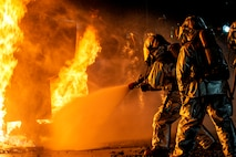Aircraft Rescue and Firefighting Marines with Headquarters and Headquarters Squadron conduct fire containment drills at Marine Corps Air Station Iwakuni, Japan, Oct. 12, 2018. The training was conducted in order to maintain proficiency extinguishing aircraft fires in support of the air station's mission of launching and recovering aircraft. ARFF is a special category of firefighting that involves the response, hazard mitigation, evacuation and possible rescue of passengers and crew of an aircraft involved in a ground emergency.