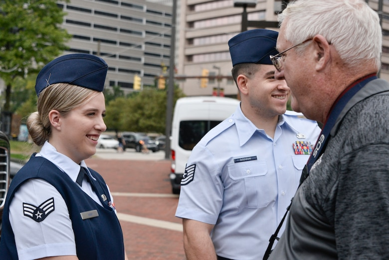 Senior Airman Kaitlyn, 94th Intelligence Squadron linguist, and Technical Sgt. Daniel Dodson, 317th Recruiting Squadron recruiter, meet local residents and talk about their career fields and Air Force opportunities during Fleet Week October 6, 2018 in Baltimore, Md. Fleet Week Baltimore gave Maryland residents a chance to meet and learn about U.S. maritime capabilities of the U.S. Navy and Marine Corps, along with promoting community growth and interaction with all services. (U.S. Air Force photo by Staff Sgt. Alexandre Montes)