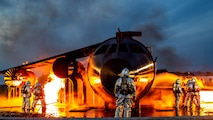 U.S. Marine Corps Sgt. Zachary Campbell, aircraft rescue and firefighting specialist with Headquarters and Headquarters Squadron, supervises fire containment drills at Marine Corps Air Station, Iwakuni, Japan, Oct. 12, 2018. The training was conducted in order to maintain proficiency extinguishing aircraft fires in support of the air station's mission of launching and recovering aircraft. Aircraft Rescue and Firefighting is a special category of firefighting that involves the response, hazard mitigation, evacuation and possible rescue of passengers and crew of an aircraft involved in a ground emergency.