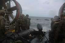 Marines with the 31st Marine Expeditionary Unit's Amphibious Reconnaissance Platoon carry a Combat Rubber Raiding Craft off a Landing Craft, Air Cushion hovercraft during Helocast and Special Patrol Insertion and Extraction training, underway in the East China Sea, Oct. 14, 2018. Helocasting and SPIE operations allow the recon Marines to enter and exit tactical landing zones that are inaccessible to helicopters during amphibious operations. The 31st MEU, the Marine Corps' only continuously forward-deployed MEU, provides a flexible force ready to perform a wide-range of military operations in the Indo-Pacific region.