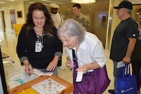Graciela Alfano (left), licensed vocational nurse, shows Joann Dick, a regular attendee, different insects that can cause various allergy reactions during the Military Retiree Appreciation Day at Brooke Army Medical Center Medical Mall Oct. 14, 2017. Military retirees and service members who are about to retire can find out about useful programs and benefits at Military Retiree Appreciation Day Oct. 20, 2018 from 8 a.m. to noon at the Brooke Army Medical Center Medical Mall.