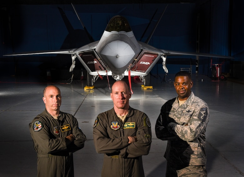 U.S. Air Force Col. Jason Hinds (center), 1st Fighter Wing commander; U.S. Air Force Col. Steve Fino (left), 1st FW vice commander; and U.S. Air Force Chief Master Sergeant Johnny Harris, 1st FW command chief, pose for a photo in front of an F-22 Raptor from the 1st FW at Joint Base Langley-Eustis, Virginia, Oct. 10, 2018. The 100-year-old 1st FW is home to the 94th Fighter Squadron, 27th FS and the 71st Fighter Training Squadron. (U.S. Air Force photo by Staff Sgt. Carlin Leslie/Released)