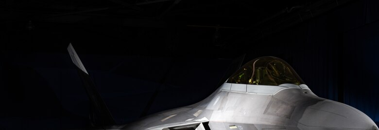 An F-22 Raptor from the 1st Fighter Wing is on display in the static display hanger at Joint Base Langley-Eustis, Virginia, Oct. 10, 2018. The F-22 Raptor on display is the flag ship aircraft of the 27th Fighter Squadron.  (U.S. Air Force photo by Staff Sgt. Carlin Leslie/Released)