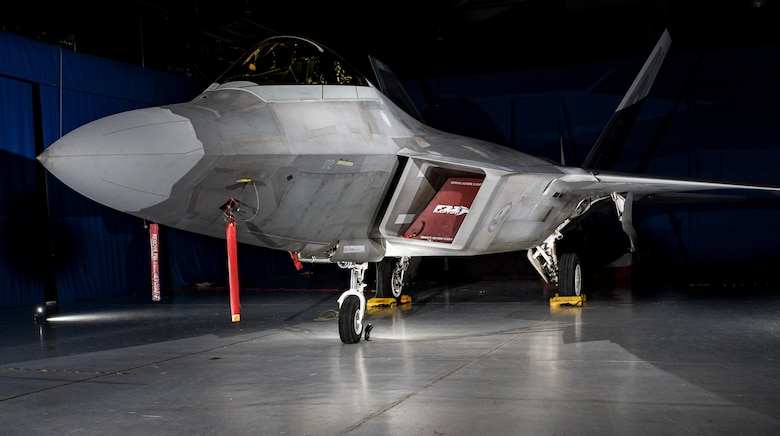 An F-22 Raptor from the 1st Fighter Wing is on display in the static display hanger at Joint Base Langley-Eustis, Virginia, Oct. 10, 2018. The F-22 Raptor on display is the flag ship aircraft of the 27th Fighter Squadron is named after Medal of Honor recipient U.S. Army Lt. Frank Luke Jr. a fighter ace from World War I who flew with the 1st Pursuit Group, 27th Aero Squadron. (U.S. Air Force photo by Staff Sgt. Carlin Leslie/Released)