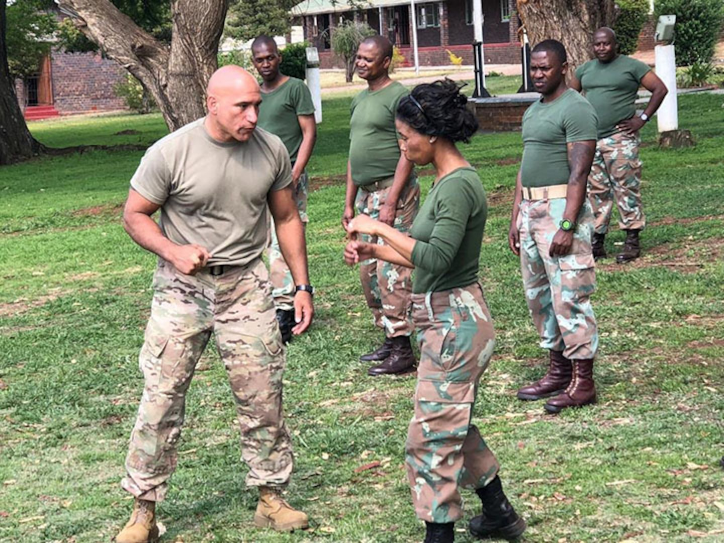 New York Army National Guard Master Sgt. Luis Barsallo, a certified hand-to-hand tactics instructor, demonstrates a move to members of the South African National Defense Forces during an  exchange visit on October 10, 2018. Soldiers from the New York Army National Guard took  part in an exchange program at the South African National Defense Forces Military Police School during an exchange visit there on Oct. 10-11, 2018.