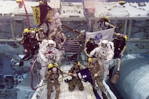 """Army astronauts Col. Andrew """"Drew"""" Morgan and Lt. Col. Anne McClain, both from the astronaut class of 2013, prepare to be promoted while underwater following required training in the Neutral Buoyancy Laboratory at the Sonny Carter Training Facility in Houston, Texas, Sept. 27, 2018.  (Photo Credit: NASA photo )"""