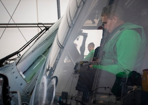 A Sailor aboard USNS Comfort conducts inspections on an MH-60S Seahawk helicopter.