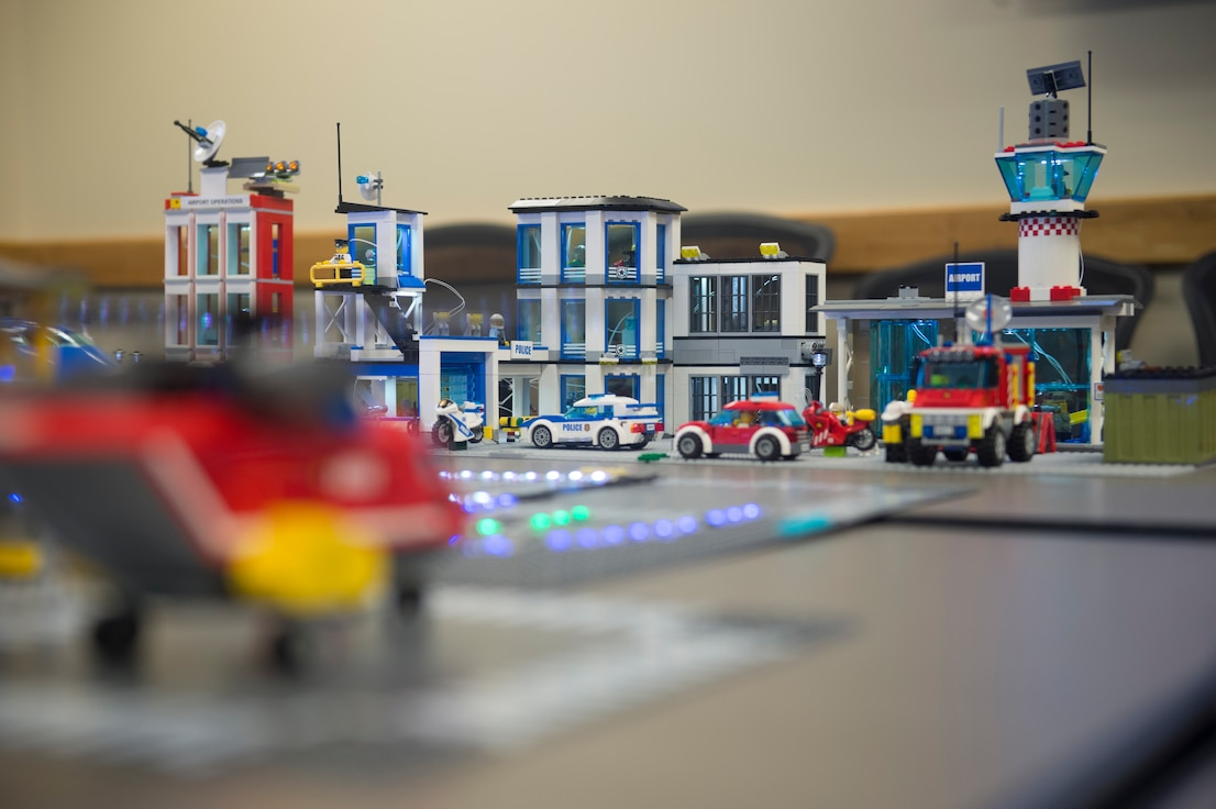 """The """"Bricks in the Loop"""" cyber-physical training platform at Joint Base San Antonio-Lackland, Texas, helps 90th Cyberspace Operations Squadron members ready the Air Force's Cyber Protection Teams. The """"loop"""" serves as a simulated Air Force installation with assets such as a fire station, police station, airport, airport passenger terminal, jets, tanker trucks and other vehicles. Trainees can digitally interact with many of the elements to simulate real-world cyber systems. (U.S. Air Force photo by Tech. Sgt. R.J. Biermann)"""