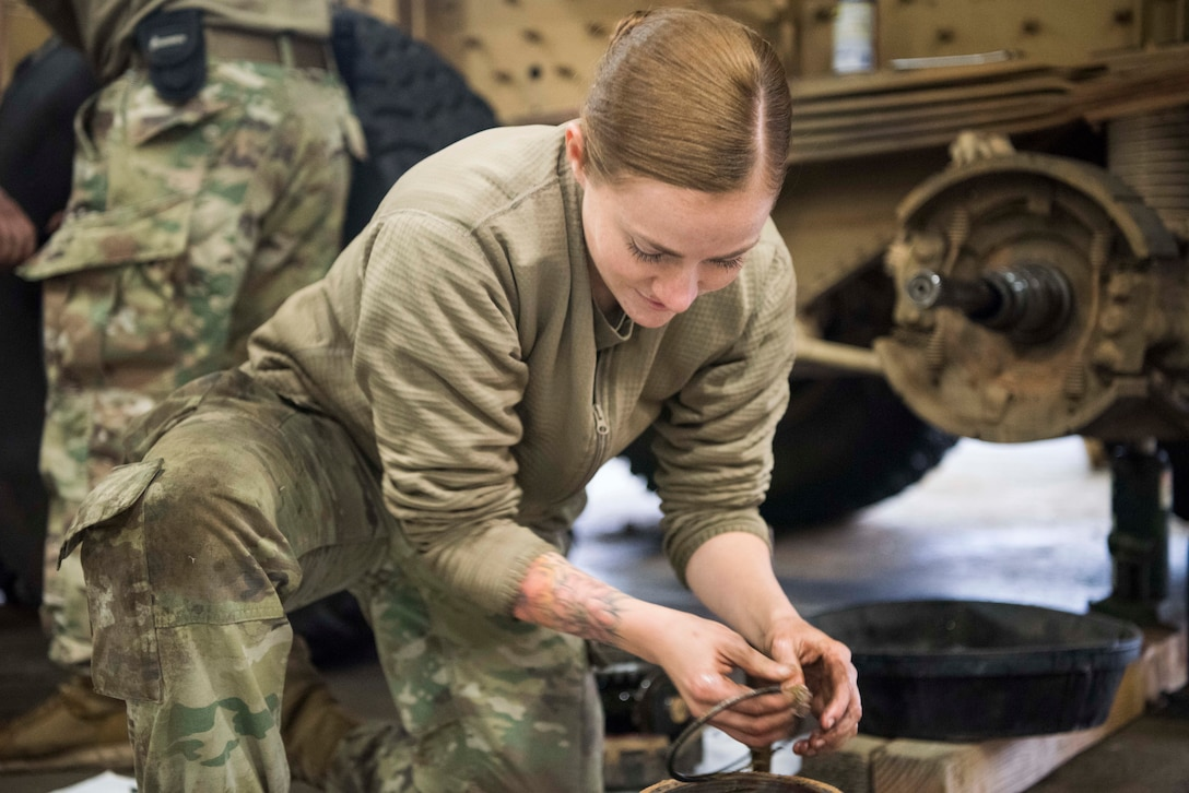 U.S. Army Spc. Savannah Padilla, a 135th Forward Support Company, 188th Brigade Support Battalion multiple launch rocket system repair mechanic, takes out a seal on a wheel hub of a M142 High Mobility Artillery Rocket System (HIMARS) during Red Flag-Alaska 19-1 at Joint Base Elmendorf-Richardson, Alaska, Oct. 11, 2018. Their unit was tasked to provide long-range artillery support for RF-A exercising interoperability with U.S. Air Force units to showcase their capabilities and develop a relationship with the other services.