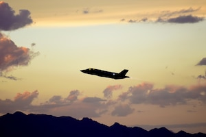 An F-35A Lightning II ascends over the mountains around Luke Air Force Base, Ariz., Oct. 11, 2018. The pilot training courses at Luke include a night flying block which lasts for a few weeks. (U.S. Air Force photo by Senior Airman Ridge Shan)