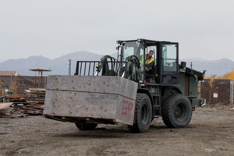 U.S. Air Force Airman 1st Class Pamela Proteau, a 773d Logistics Readiness Squadron vehicle operator, picks up a crate using a 10k all-terrain forklift to remove wreckage debris at Joint Base Elmendorf-Richardson, Alaska, Sept. 27, 2018. Proteau was part of a large wreckage disposal team whose mission was to remove debris from the fatal crash of the Sitka 43 C-17 Globemaster III that had been stored at JBER since 2010. After multiple shipments, the 'Sitka 43' wreckage is finding a new purpose at the Air Force Safety Center (AFSEC) Crash Lab at Kirtland Air Force Base, N.M.