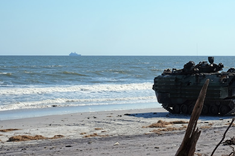 An Amphibious Assault Vehicle with the 24th Marine Expeditionary Unit prepares to embark on USS New York (LPD 21) Oct. 3 in preparation for Exercise Trident Juncture 2018.  Events during Trident Juncture will provide the 24th MEU opportunities to train as a Marine Air Ground Task Force in unique environments in support of partner nations. (U.S. Marine Corps photo by Gunnery Sgt. Robert Durham)