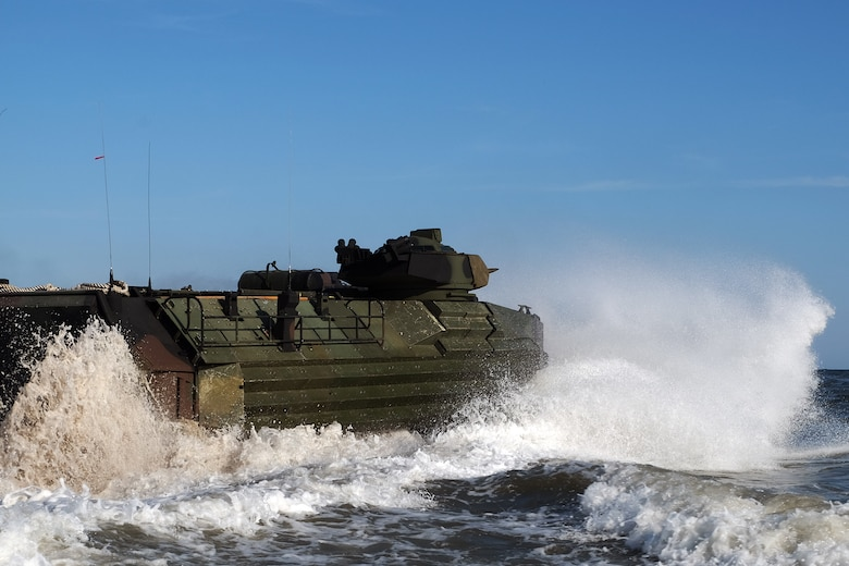 An Amphibious Assault Vehicle with the 24th Marine Expeditionary Unit enters the water aboard Camp Lejeune Oct. 3 to embark on USS New York (LPD 21) in preparation for Exercise Trident Juncture 2018.  Events during Trident Juncture will provide the 24th MEU opportunities to train as a Marine Air Ground Task Force in unique environments in support of partner nations. (U.S. Marine Corps photo by Gunnery Sgt. Robert Durham)