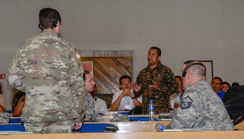 El Salvador Army Capt. Leonel Maye, center standing, artillery commander for La Fuerza Armada de El Salvador, discusses cyber security and cyber defense with the New Hampshire National Guard team visiting San Salvador, El Salvador, September 25, 2018. The discussions are part of the ongoing partnership between New Hampshire and El Salvador under the National Guard State Partnership Program. (N.H. National Guard photo by Tech. Sgt. Aaron Vezeau)