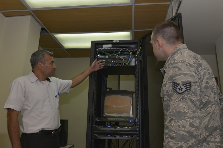 Arnoldo Inocencio Rivas Molina, a force development sustainment systems engineer with La Fuerza Armada de El Salvador, shows off a virtual cyber training system to U.S. Air Force Staff Sgt. Alan Dwyer, a cyber systems operations specialist assigned to the 157th Communications Flight, New Hampshire Air National Guard, San Salvador, El Salvador, Sept. 27, 2018. Dwyer is part of a multi-state National Guard State Partnership Program, headed by the New Hampshire National Guard, in order to help assess and determine recommendations for the Salvadoran Army as they stand up a cyber security unit. (N.H. Air National Guard photo by Tech. Sgt. Aaron Vezeau)