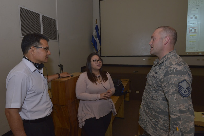 Ramon Argueta, an IT network security technician, discusses communication organizational structure with U.S. Air Force Master Sgt. Gabriel Howard, a cyber transport specialist assigned to the 157th Communications Flight, New Hampshire Air National Guard, by way of Interpreter Ms. Maggie Vega, San Salvador, El Salvador, Sept. 27, 2018. Howard is part of a multi-state National Guard State Partnership Program, headed by the New Hampshire National Guard, in order to help assess and determine recommendations for the Salvadoran Army as they stand up a cyber security unit. (N.H. Air National Guard photo by Tech. Sgt. Aaron Vezeau)