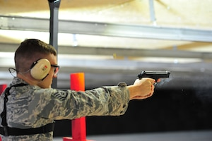 Staff Sgt. Jeffrey Grossi, a photojournalist with the 910th Airlift Wing, fires an M9 at a target at Youngstown Air Reserve Station's new Combat Arms Training and Maintenance firing range Oct. 13, 2018.