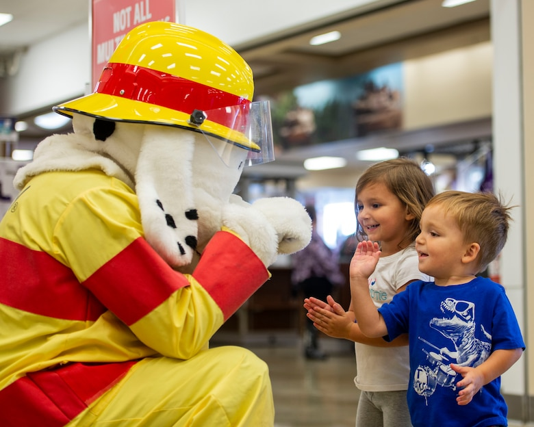 Sparky the fire dog interacts children during a visit to the Army and Air Force Exchange Service at Scott Air Force Base as part of 2018 National Fire Prevention Week, Oct. 10. Throughout the week the fire department visited the Child Development Centers, Scott Elementary School, the Scott Youth Center, hosted a puppet show at the base library, and held an open house and Fall Festival at Fire Station 2 on base. (U.S. Air Force photo by Airman 1st Class Chad Gorecki)