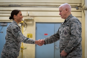 U.S. Air Force Lt. Gen. L. Scott Rice, the director of the Air National Guard, coins Tech. Sgt. Rachael Blasko, an enlisted accessions recruiter with the 182nd Force Support Squadron, during a visit to the 182nd Airlift Wing in Peoria, Ill., Oct. 14, 2018.