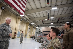 U.S. Air Force Lt. Gen. L. Scott Rice, Director of the Air National Guard, discusses military service with Airman 1st Class Alexa Vamvakos, commander support staff for the 168th ASOS squadron during an All Call, Peoria, Ill., October 14, 2018