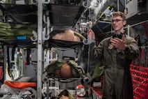 Senior Airman Brannon Tullos, 375th Aeromedical Evacuation Squadron, speaks about the capabilities of a C-130 Globemaster fuselage trainer Oct. 12, 2018 at Scott Air Force Base, Illinois. The fuselage trainer provides a controlled environment where the 375th AES can schedule lifelike, high-fidelity task training and mission simulations. (U.S. Air Force photo by Senior Airman Melissa Estevez)