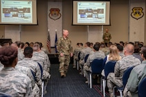 Maj. Gen. Sam Barrett, 18th Air Force commander, speaks during a commander's call Oct. 12, 2018 at Scott Air Force Base, Illinois. A commander's call is a direct form of communication were Airmen of different units, who don't always get an opportunity to speak to the commander, can voice their opinions and receive vital information. (U.S. Air Force photo by Senior Airman Melissa Estevez)
