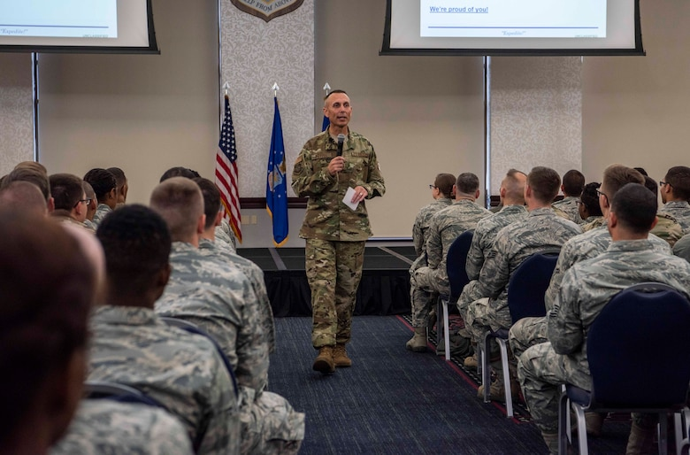 Chief Master Sgt. Todd Petzel, 18th Air Force command chief, speaks during a commander's call Oct. 12, 2018 at Scott Air Force Base, Illinois. Petzel focused on the acronym AMC, which stood for Airmen, Mission and Culture. He emphasized that nothing happens alone and a cohesive team is needed in order to complete the mission. (U.S. Air Force photo by Senior Airman Melissa Estevez)