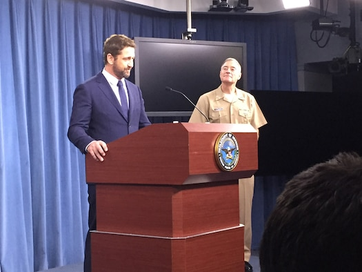 "Actor Gerard Butler and Navy Vice Adm. Fritz Roegge, current president of the National Defense University, speak about the movie ""Hunter-Killer"" during a Pentagon news conference, Oct. 15, 2018. DOD photo by Jim Garamone"