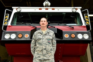 Master Sgt. Jared Dudden, 341st Civil Engineer Squadron assistant chief for training, poses for a picture October 9, 2018, at Malmstrom Air Force Base, Mont. Dudden received the 2018 Fireman of the Year award from the Exchange Club of Great Falls. (U.S. Air Force photo by Airman 1st Class Jacob M. Thompson)