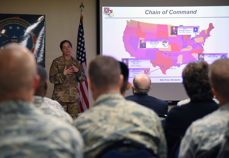 U.S. Air Force Lt. Col. Jennifer Carns, 85th Engineering Installation Squadron commander, delivers a mission briefing during an open house inside Maltby Hall at Keesler Air Force Base, Mississippi, Oct. 11, 2018. Tower rescue and fiber splicing demonstrations were conducted as well as tours inside the tool cage, telecommunications lab and the electromagnetics lab. (U.S. Air Force photo by Kemberly Groue)