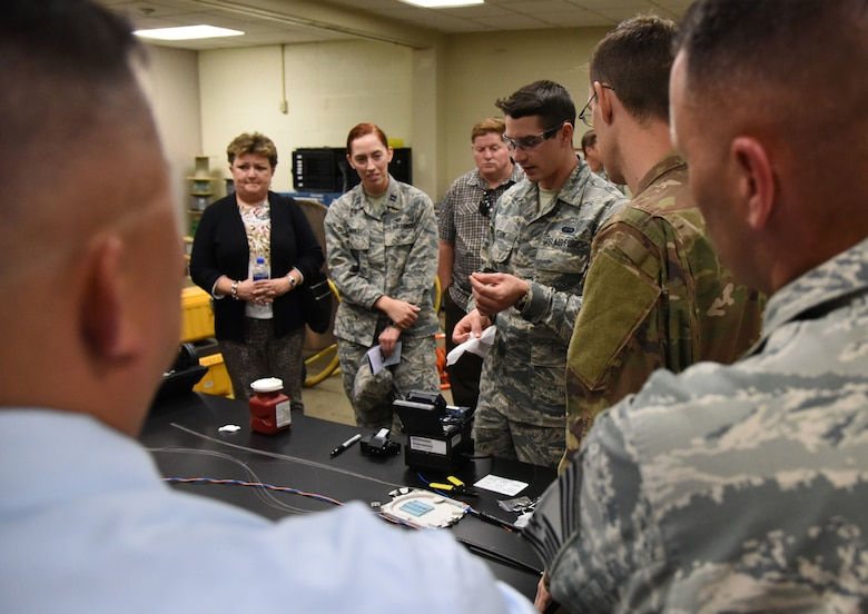U.S. Air Force Airman Trent Olson, 85th Engineering Installation Squadron cable and antenna systems technician, conducts a cable splicing demonstration during an open house inside Maltby Hall at Keesler Air Force Base, Mississippi, Oct. 11, 2018. Keesler leadership and personnel attended the event to become more familiar with the 85th EIS mission capabilities. (U.S. Air Force photo by Kemberly Groue)