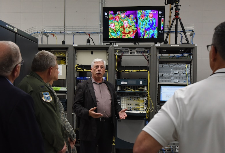 Randal Blanchard, 85th Engineering Installation Squadron senior electronics engineer, briefs on the telecommunications lab capabilities during the 85th EIS open house inside the Annex building at Keesler Air Force Base, Mississippi, Oct. 11, 2018. Keesler leadership and personnel attended the event to become more familiar with the 85th EIS mission capabilities. (U.S. Air Force photo by Kemberly Groue)