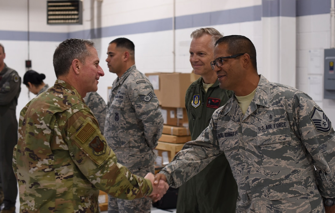 Air Force Chief of Staff Gen. David L. Goldfein congratulates Master Sgt. Manuel Maciel-Rodriguez, noncommissioned officer-in-charge of the 301st Medical Squadron's aerospace medicine operations section, for being named a superior performer Oct. 13, 2018, at Naval Air Station Fort Worth Joint Reserve Base, Texas. Maciel-Rodriguez was recognized for streamlining clinic processes, decreasing wait time and boosting the wing's readiness. Goldfein recognized five superior performers during his visit to the wing. (U.S. Air Force photo by Tech. Sgt. Charles Taylor)