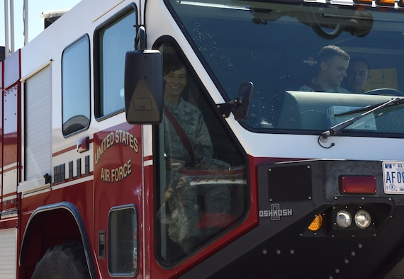 U.S. Air Force Col. Debra Lovette, 81st Training Wing commander, receives a courtesy ride in a fire truck during an  open house at the fire station at Keesler Air Force Base, Mississippi, Oct. 13, 2018. Keesler ended its Fire Prevention Week celebration with  an open house which consisted of displays, fire tuck rides and fire prevention demonstrations. (U.S. Air Force photo by Kemberly Groue)