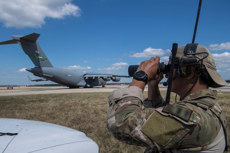 A Special Tactics Airman with the 23rd Special Tactics Squadron looks through binoculars at Tyndall Air Force Base, Florida, Oct. 14, 2018.