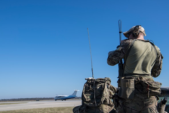 A Special Tactics Airman with the 23rd Special Tactics Squadron controls an aircraft at Tyndall Air Force Base, Florida, Oct. 14, 2018.