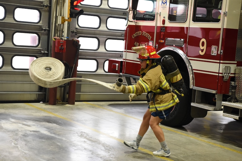 Airman 1st Class Michelle Medina, a 28th Logistics Readiness Squadron fuels facility operator, unravels a hose during the Firefighter Challenge at Ellsworth Air Force Base, S.D., Oct. 5, 2018. The challenge was one many events hosted by the 28th Civil Engineer Squadron fire protection flight during National Fire Prevention and Safety Week. (U.S. Air Force photo by Airman 1st Class Thomas Karol)