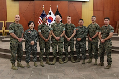 CAMP HUMPHREYS, Republic of Korea – Maj. Gen. Patrick J. Hermesmann (center), commander of U.S. Marine Corps Forces Korea, and Sgt. Maj. Michael R. Saucedo (far left), sergeant major of MARFORK, congratulate U.S. and Republic of Korea Marines at their graduation for Backbone University here, Oct. 12. Backbone University, which supports Combined Forces Command, United Nations Command, and U.S. Forces Korea, teaches the non-commissioned officers about NCO leadership in a combined joint operating environment. (U.S. Marine Corps photo by Sgt. Nathaniel Hanscom/Released)