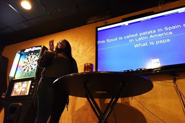 Senior Airman Kashe Smith, a 28th Medical Group public health technician, asks a question about Hispanic culture at Ellsworth Air Force Base, S.D., Oct. 12, 2018. The trivia night was held in celebration of Hispanic Heritage Month, which is celebrated nationwide Sept. 15-Oct. 15. (U.S. Air Force photo by Airman 1st Class Thomas Karol)