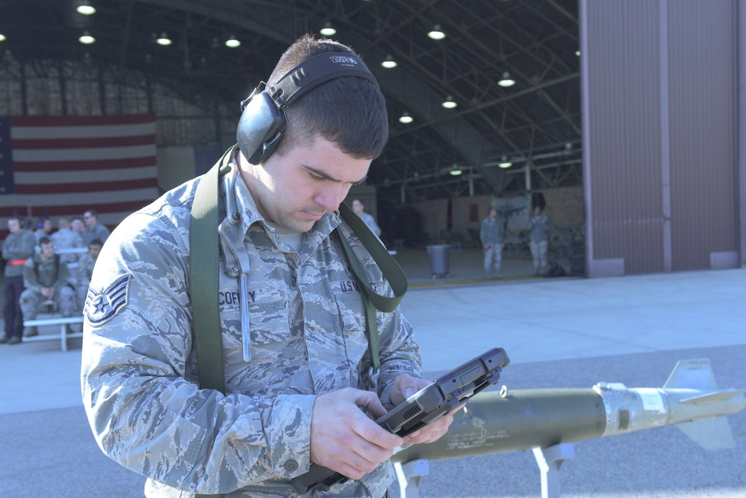 U.S. Air Force Staff Sgt. Cody Coffee, a weapons load crew member 51st Aircraft Maintenance Squadron, reviews a technical order during a load crew competition at Osan Air Base, Oct. 12, 2018. Air Force maintenance units began utilizing digital tablets to display technical order manuals in 2014 to mitigate frequent crashes and the poor battery life of formally used ruggedized laptops. (U.S. Air Force photo by Staff Sgt. Timothy Dischinat)