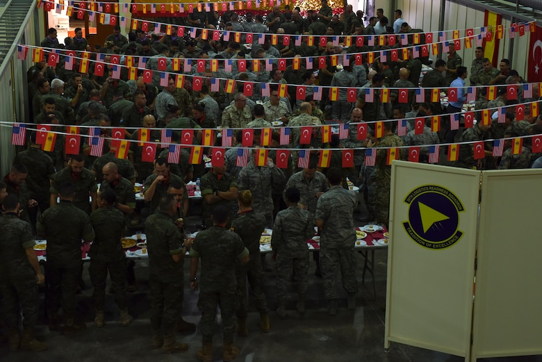U.S. Air Force, Spanish Army and Turkish Air Force service members gather to enjoy Spanish food, following the Hispanity Day parade at Incirlik Air Base, Turkey, Oct. 12, 2018.