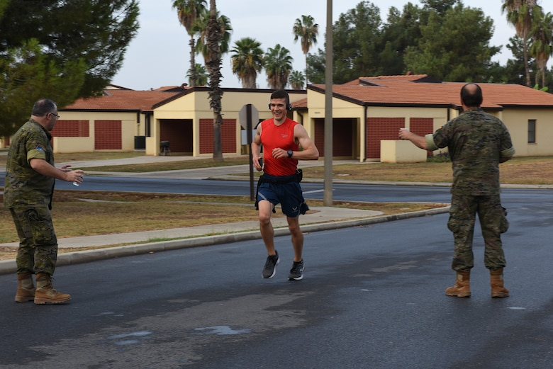 U.S. Air Force 1st Lt. Nikita Albert, 39th Logistics Readiness Squadron material management flight commander, participates in the Hispanity Day 8K run at Incirlik Air Base, Turkey, Oct. 13, 2018.