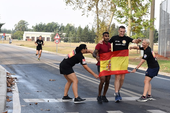 U.S. Air Force Capt. Keven Abraham, 39th Security Forces Squadron officer in charge of logistics and resources, finishes the Hispanity Day 8K run alongside a member of the Spanish Army at Incirlik Air Base, Turkey, Oct. 13, 2018.