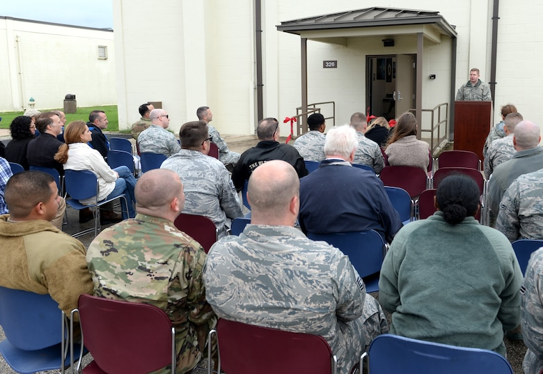 Lt. Col. Benjamin George, 346th Test Squadron commander, addresses attendees during a ribbon cutting ceremony at Joint Base San Antonio-Lackland Medina Annex, Texas, Oct. 15, 2018. The ceremony was hosted to welcome the UCAP team to its new home. The team provides Department of Defense Information Network Approved Products List testing of communications equipment before the equipment can be connected to the DODIN. UCAP is the only Air Force lab that provides DODIN APL testing and results are accepted DOD-wide. (U.S. Air Force photo by Tech. Sgt. R.J. Biermann)