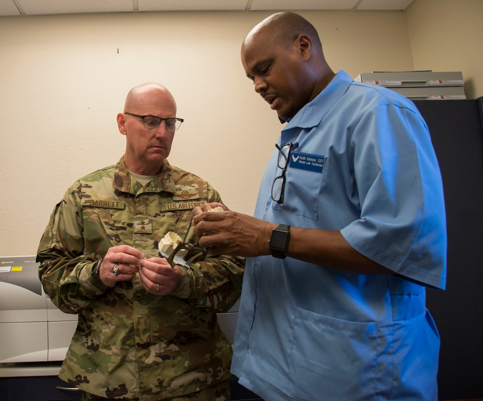 Maj Gen. Sam Barrett, 18th Air Force commander, is shown the process to make a dental crown by Keith Kimmon 375th Dental Squadron dental lab technician, Oct.11, 2018, at Scott Air Force Base, Illinois. The 375th Dental squadron is responsible for providing dental care to all members of Scott AIR FORCE BASE. (U.S. Air Force photo by Airman 1st Class Nathaniel Hudson)