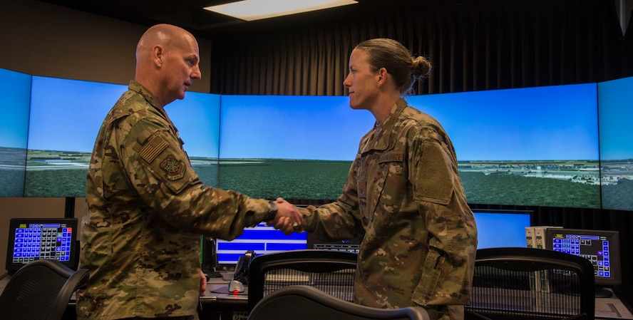 Maj. Gen. Sam Barrett, 18th Air Force commander, coins Master Sgt. Patricia Tate, 375th Operations Support Squadron air traffic controller, Oct.11, 2018, at Scott Air Force Base, Illinois. Tate was coined for being an exceptional performer within the squadron. (U.S. Air Force photo by Airman 1st Class Nathaniel Hudson)