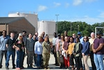 DLA Energy employees stand in front of Defense Fuel Support Point at Andrews Air Force Base, Maryland, during a site-visit tour Sept. 26.  Photo by Elizabeth Stoeckmann