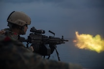 A reconnaissance Marine with the 31st Marine Expeditionary Unit's Amphibious Reconnaissance Platoon fires an M249 squad automatic weapon during marksmanship training aboard the amphibious assault ship USS Wasp, underway in the East China Sea, Oct. 16, 2018. Marines with ARP specialize in close-quarters tactics during amphibious operations. The 31st MEU, the Marine Corps' only continuously forward-deployed MEU, provides a flexible force ready to perform a wide-range of military operations in the Indo-Pacific region.